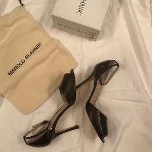 Like new Manolo Blahnik patent leather peep toes.